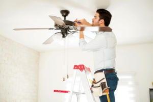 Man Fixing Ceiling Fan
